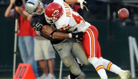 Oakland Raiders Justin Fargas, #25, fumbles after getting hit by Kansas City Chiefs Bernard Pollard, #49, in the fourth quarter of their game on Sunday, November 30, 2008 at the Oakland Coliseum in Oakland, Calif. Kansas City Chiefs Brandon Flowers, #24,